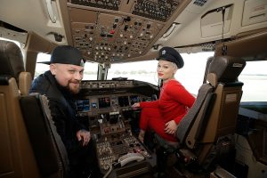 SYDNEY, AUSTRALIA - JUNE 30: Singer Jessie J and Benji Madden pose in the cockpit of a British Airways 777-300 on June 30, 2016 in Sydney, Australia.The singer-songwriter played an acoustic set for VIPs and competition winners to celebrate the arrival of summer in the UK. (Photo by Mark Metcalfe/Getty Images for British Airways) *** Local Caption *** Jessie J;Benji Madden